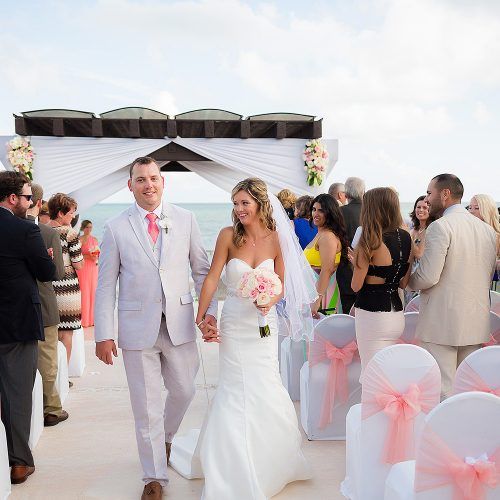 Bride and groom walking after wedding ceremony at NOW Jade Riviera Cancun