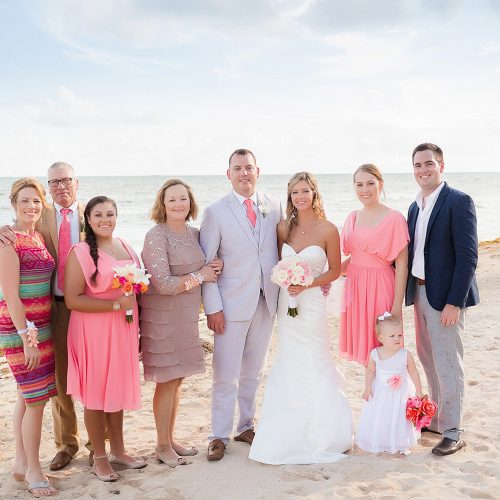 Family on beach at Jade Riviera Cancun wedding