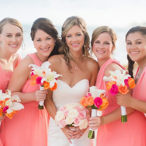 Bride and bridesmaids at wedding on beach at NOW Jade Riviera Cancun