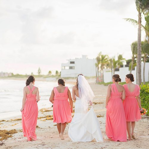 Bridesmaids walking on beach at NOW Jade Riviera Cancun