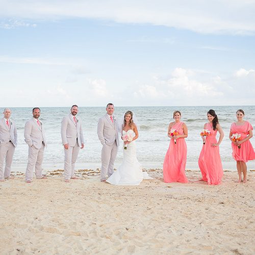 Bridal party on beach with ocean in background at NOW Jade Riviera Cancun