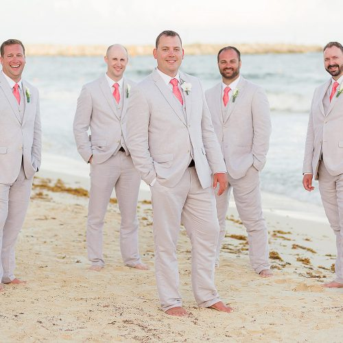 Portrait of groomsmen on beach at NOW Jade Riviera Cancun wedding