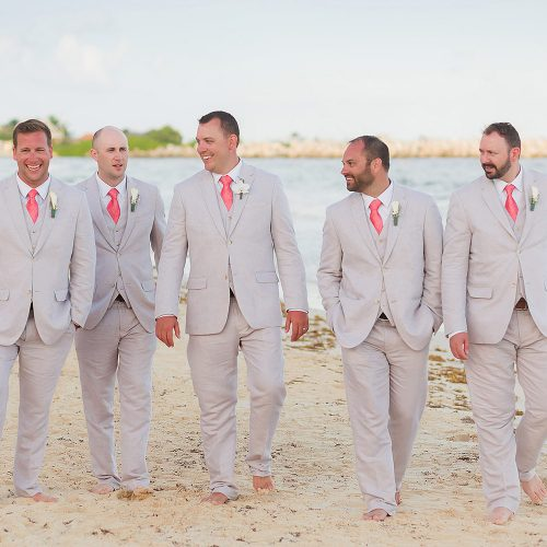 Groomsmen walking on beach at NOW Jade Riviera Cancun wedding