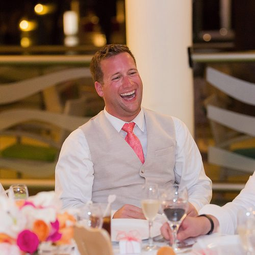 Groomsman laughing at speech at NOW Jade Riviera Cancun wedding