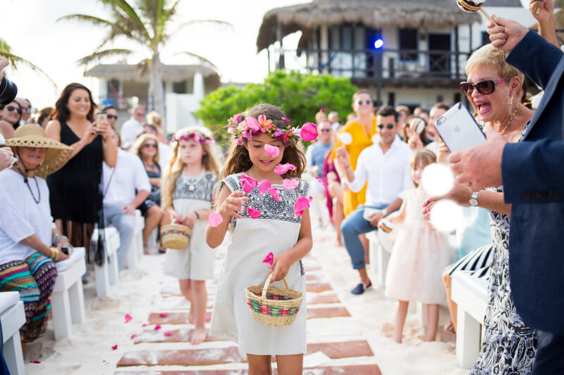 Flower girl walking down the isle | Dean Sanderson Weddings