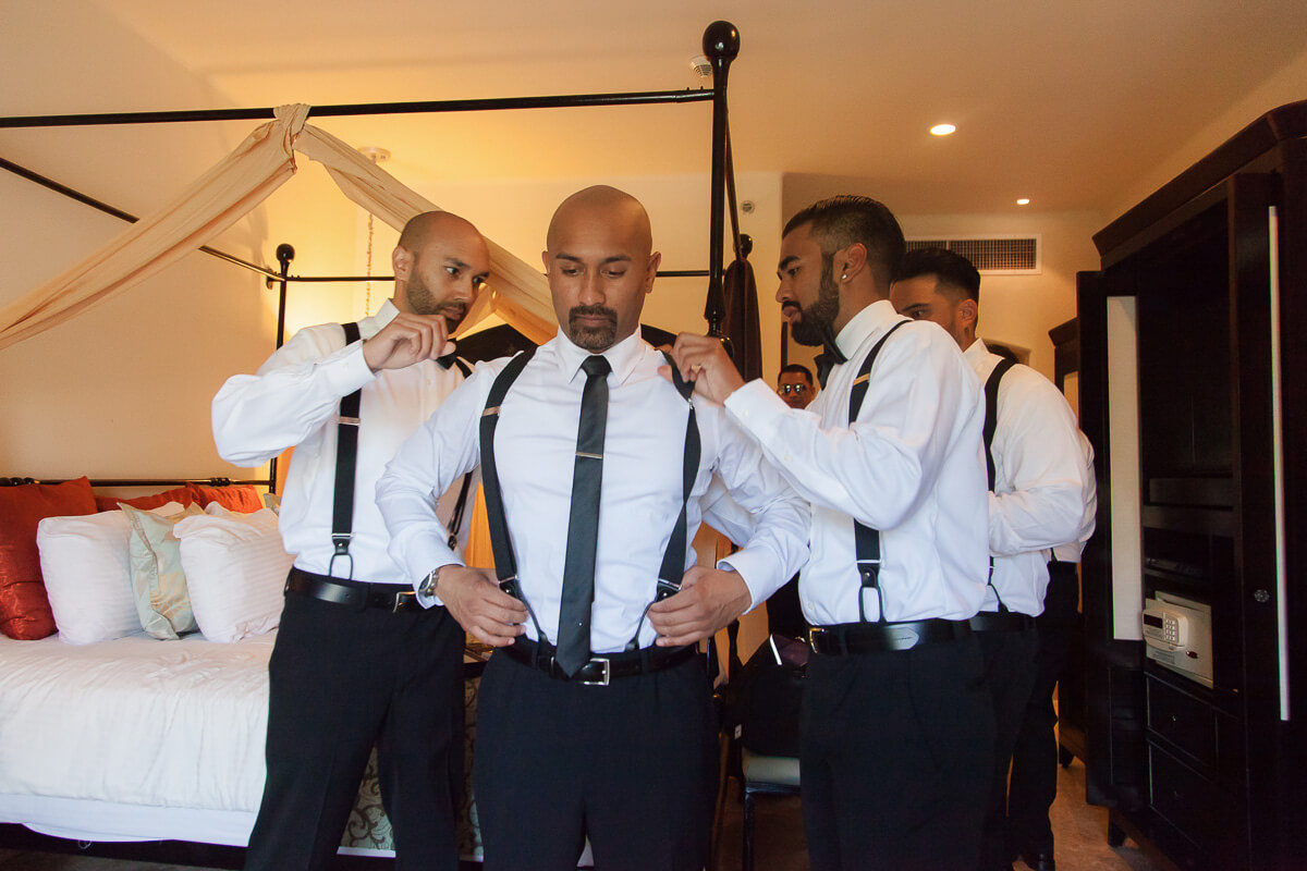 Groomsmens getting ready in room at Secrets Maroma, Riviera Maya