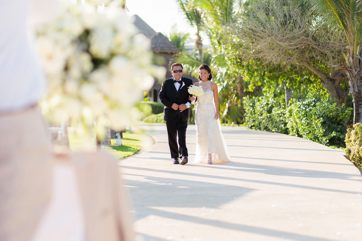 Bride walking down aisle at Secrets Maroma, Riviera Maya wedding