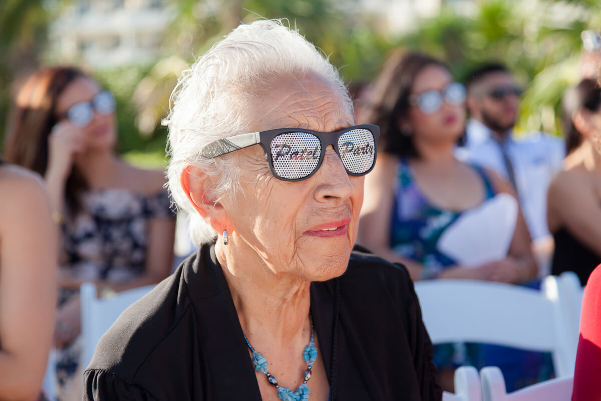 Grandmother with cool glasses on watching wedding ceremony
