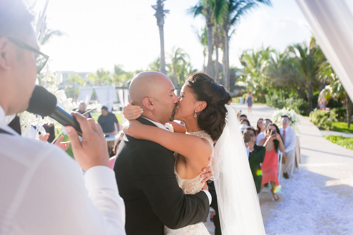 First kiss at wedding ceremony at Secrets Maroma, Riviera Maya