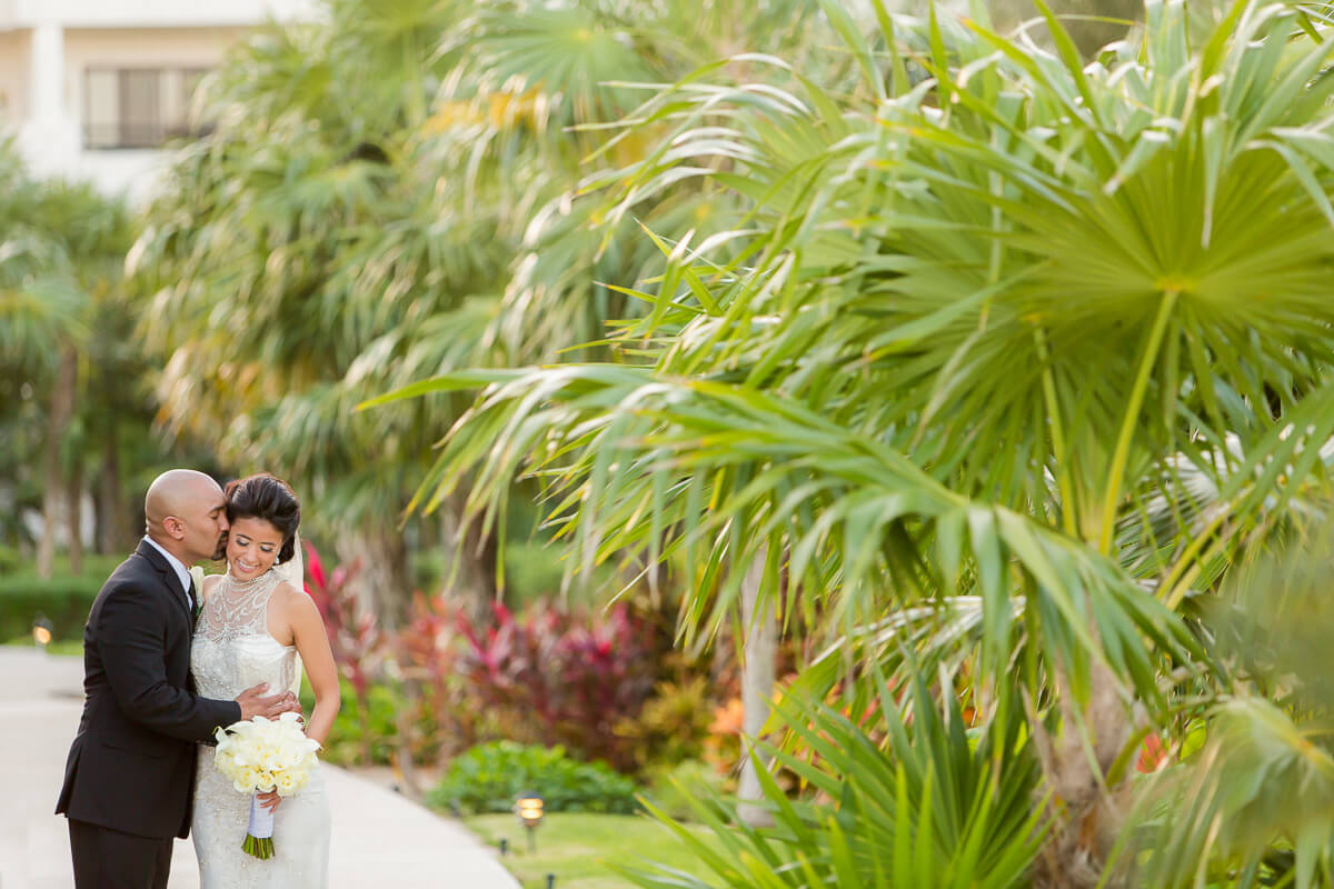 Bride and groom in garden Secrets Maroma wedding