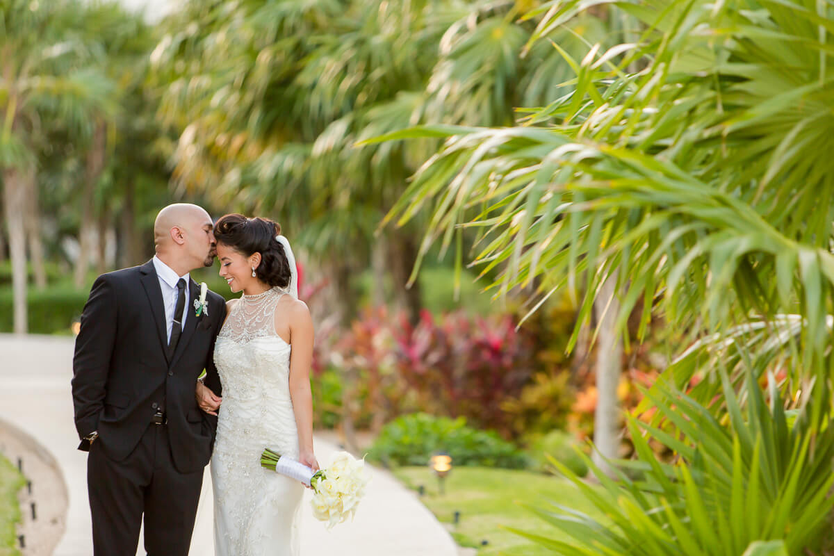 Bride and groom in garden Secrets Maroma