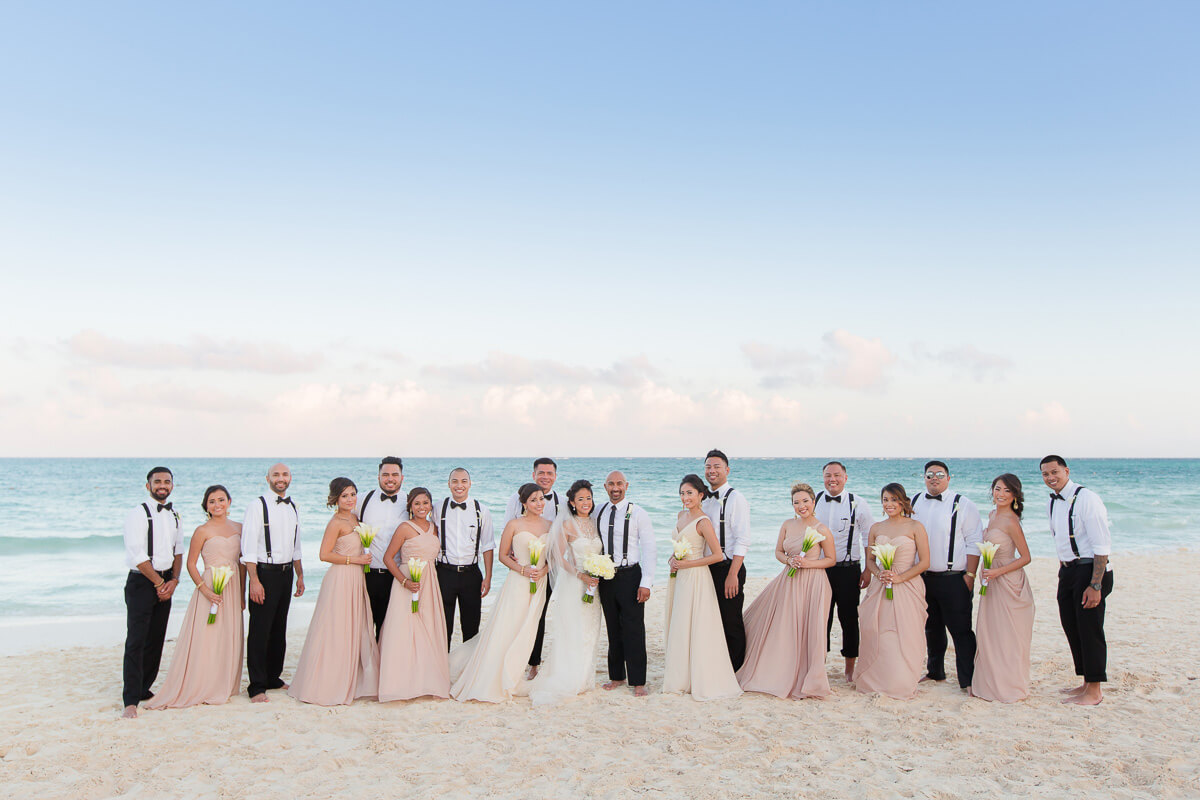 Bridal party on beach at Secrets Maroma wedding