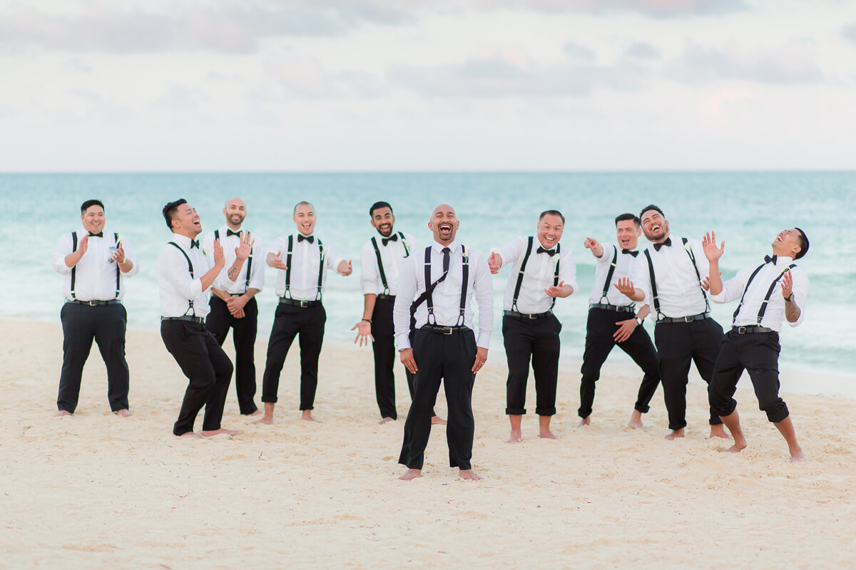 Groomsmen on beach at Secrets Maroma
