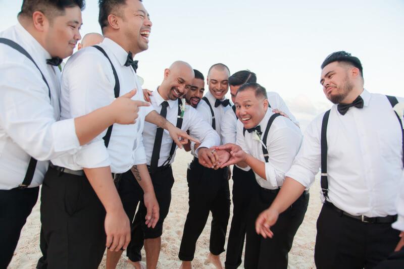 Groomsmen having fun at Secretes Maroma Beach Riviera Cancun, Mexico