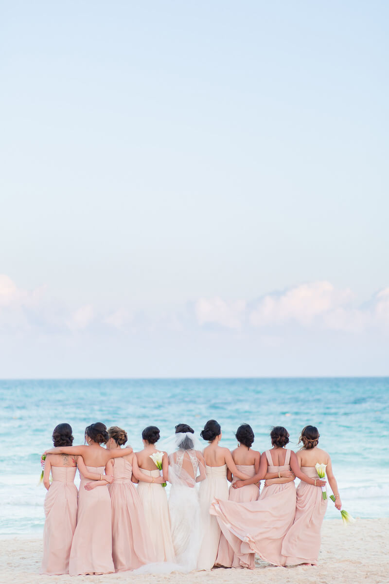 Bridesmaids looking away on beach at Secrets Maroma