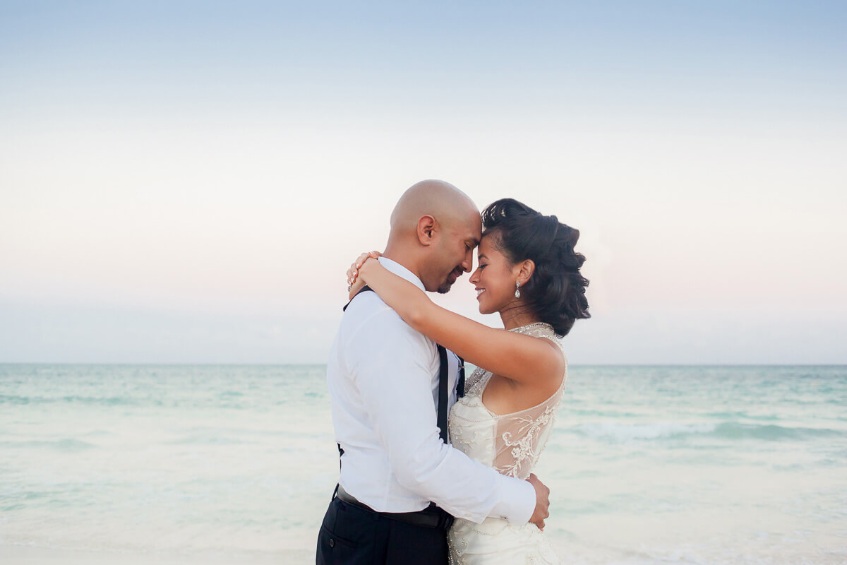 Bride and groom on beach at Secrets Maroma