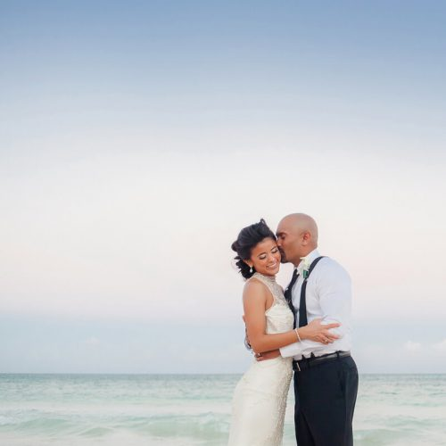 Bride and groom on beach at Secrets Maroma | Dean Sanderson Weddings