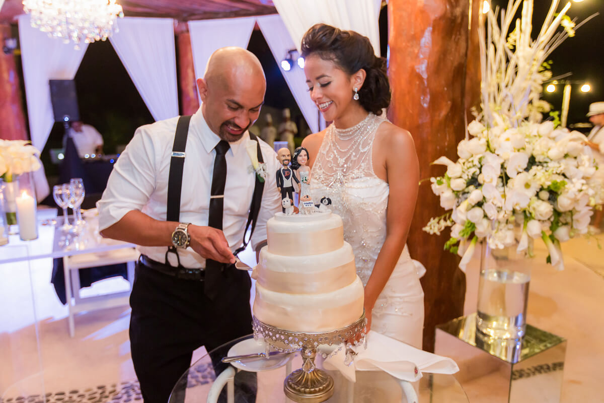 Bride and groom cutting cake at Secrets Maroma wedding
