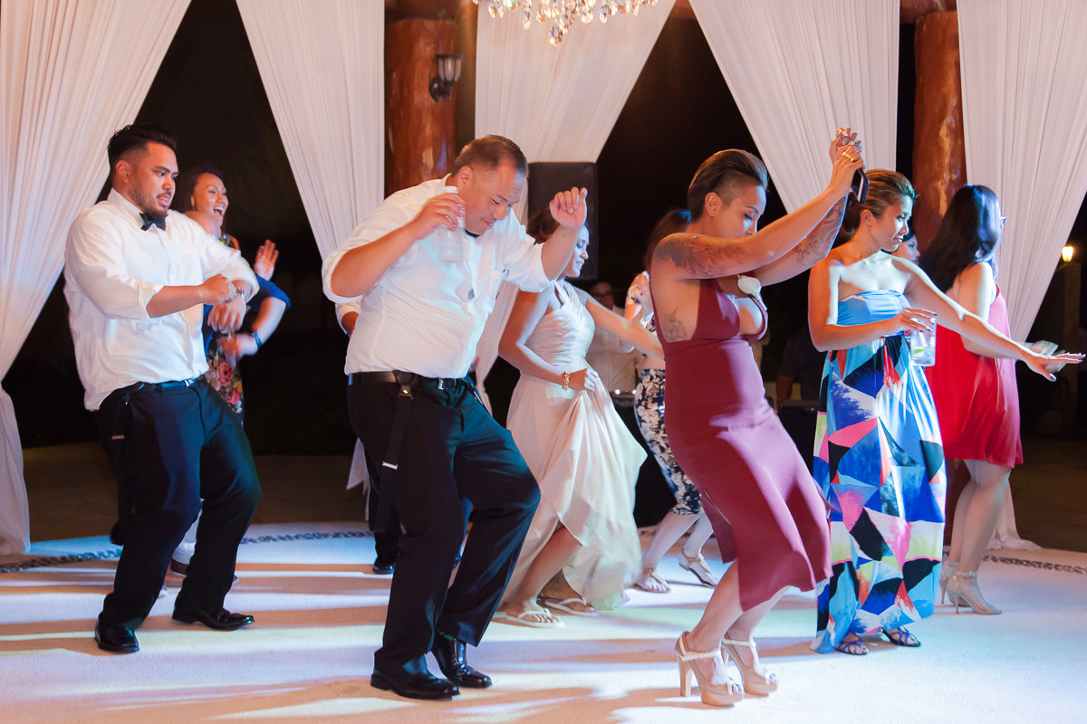 Guests dancing at wedding reception at Secrets Maroma