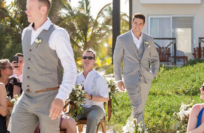 Groom walking down aisle in Tulum
