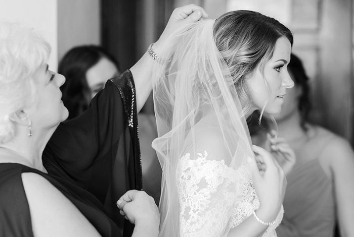 Bride having veil put in at Cancun wedding
