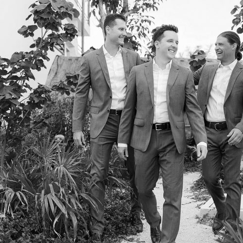 Groomsmen walking at Secrets Akumal Riviera Maya resort