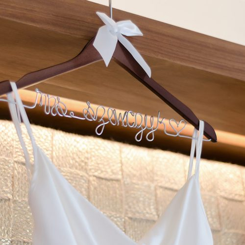 Close up of brides dress hanger