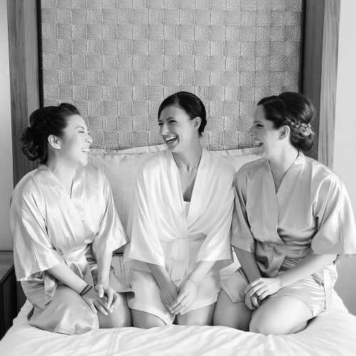 Bride and bridesmaids on bed at Secrets Akumal Riviera Maya wedding