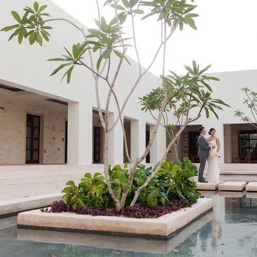 Portrait of bride and groom in garden at Secrets Akumal Riviera Maya