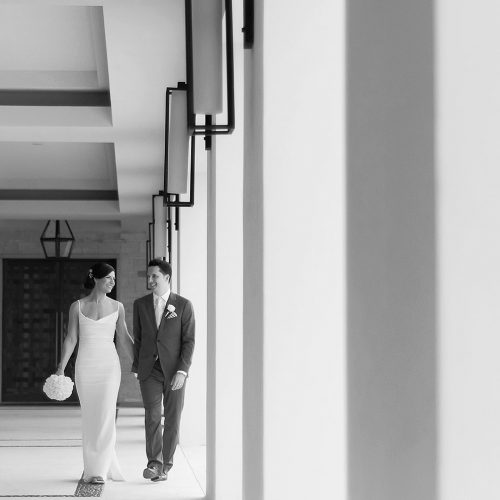 Bride and groom walking in hallway at Secrets Akumal Riviera Maya