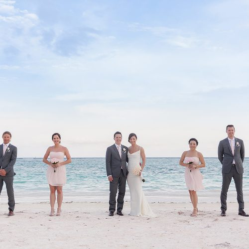 Bridal party on beach at Secrets Akumal Riviera Maya after wedding