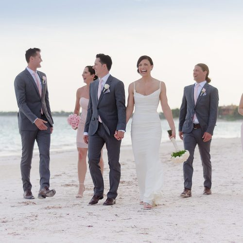 Bridal party walking on beach at Secrets Akumal Riviera Maya
