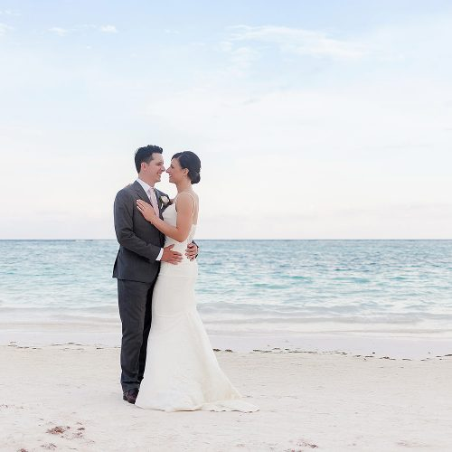 Bride and groom on beach after wedding at Secrets Akumal Riviera Maya