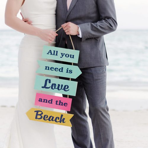 Fun sign held by bride and groom.