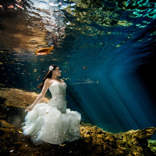 Bride underwater in Trash the Dress in Mayan Cenote, Mexico