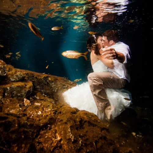 Bride and groom kissing underwater in Trash the Dress, Riviera Maya Mexico
