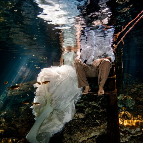 Half of bride and groom underwater Trash the Dress, Riviera Maya