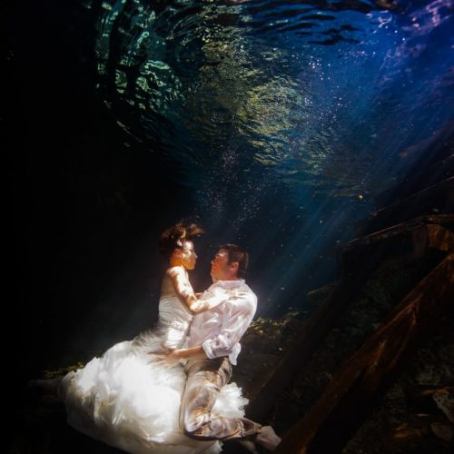 Bride and Groon underwater in Mayan Cenote Trash the dress.