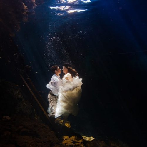 Bride and groom underwater kissing in Trash the Dress, Riviera Maya Mexico