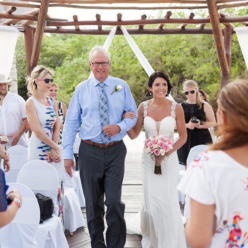 Father of the bride walking her down the aisle at Playa del Carmen Riviera Maya wedding