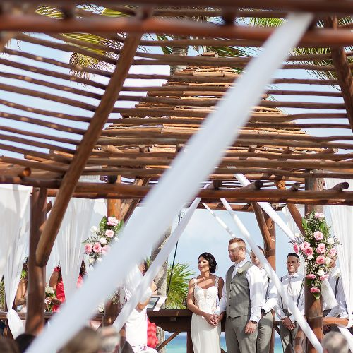 couple portrait under wooden gazebo at Playa del Carmen Riviera Maya wedding