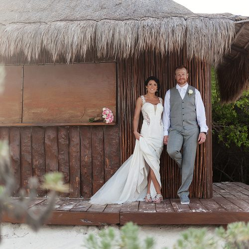 bride and groom under gazeebo for wedding photography at Playa del Carmen Riviera Maya
