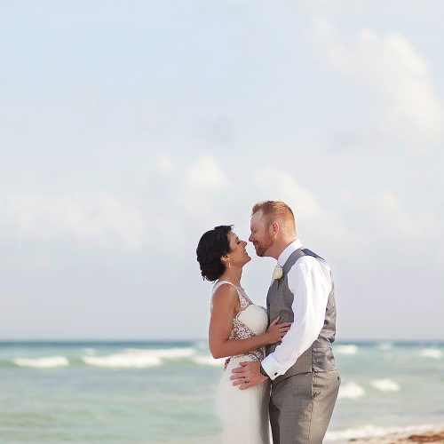 Bride and groom almost kissing on the beach in Playa del Carmen