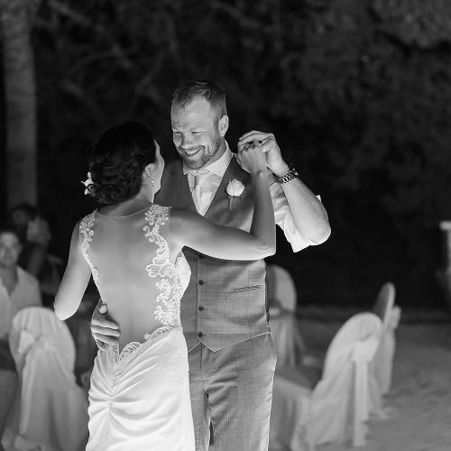 Black and white photography of bride and grooms dancing at Riviera Maya wedding