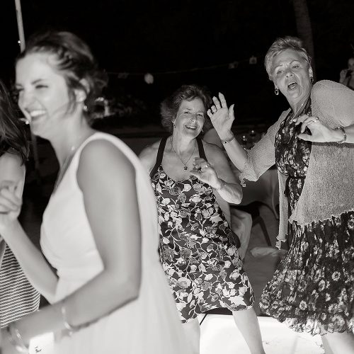 guests having fun in black and white photography at Riviera Maya wedding