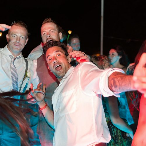 guys posing funny for wedding at Playa del Carmen wedding reception