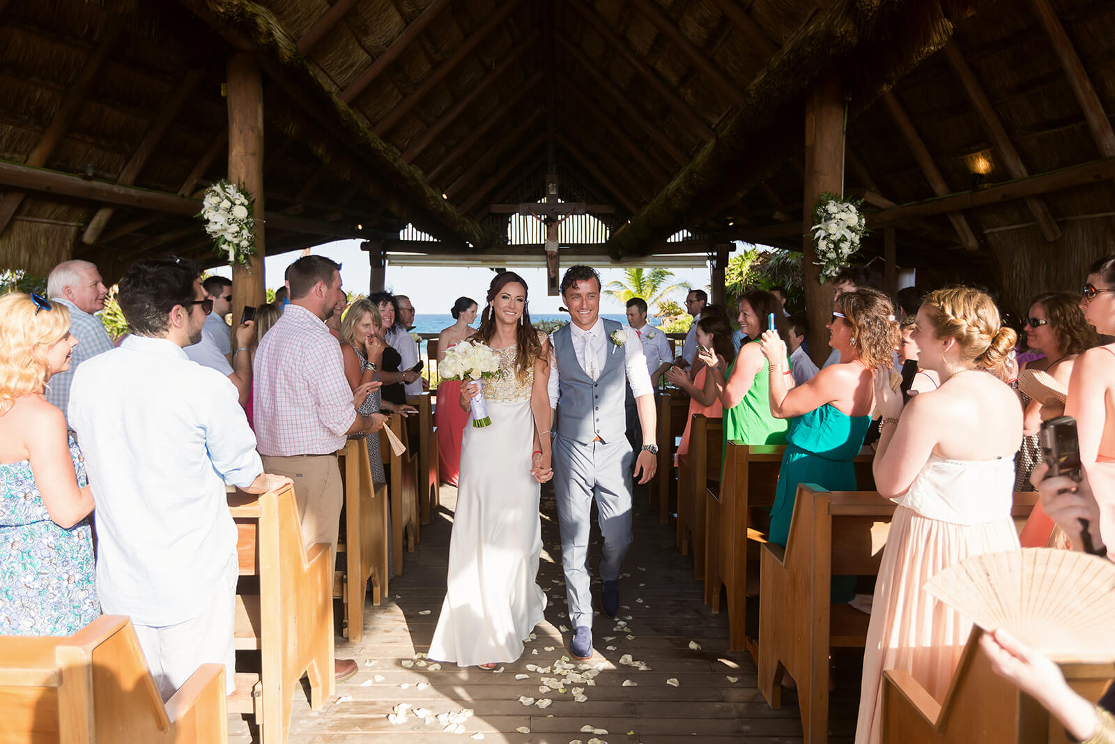 Bride and Groom walking out of chapel at Grand Sirenis Riviera Maya Wedding