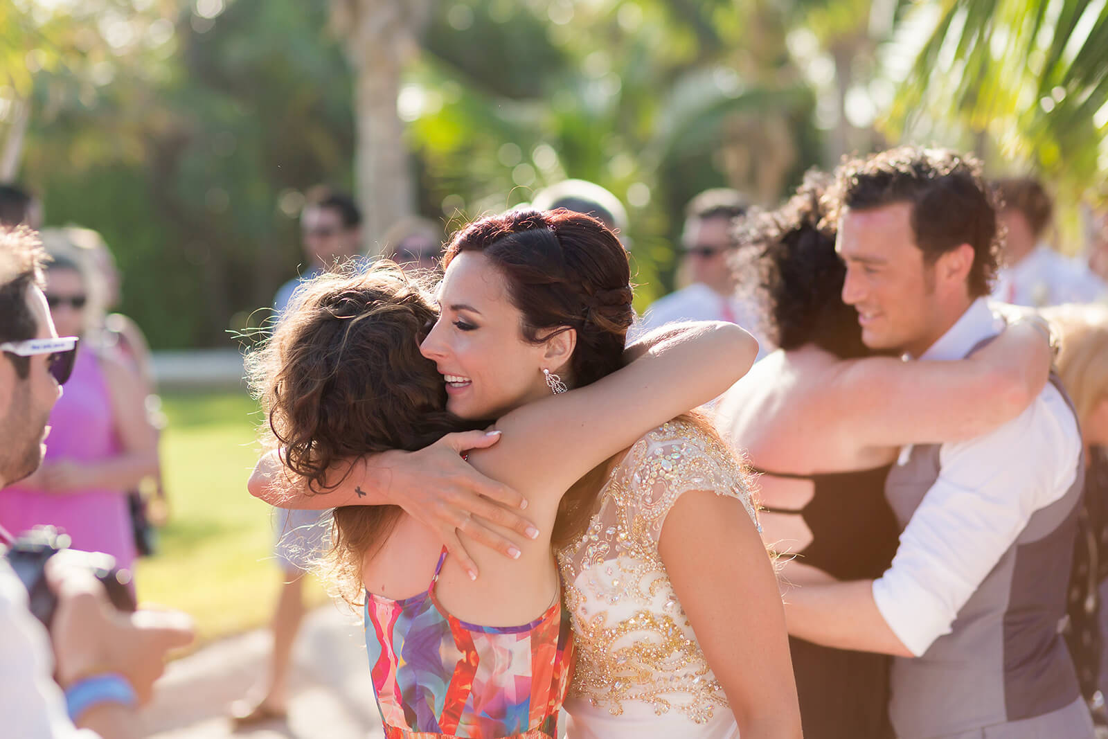 Bride hugging guest at Grand Sirenis Riviera Maya