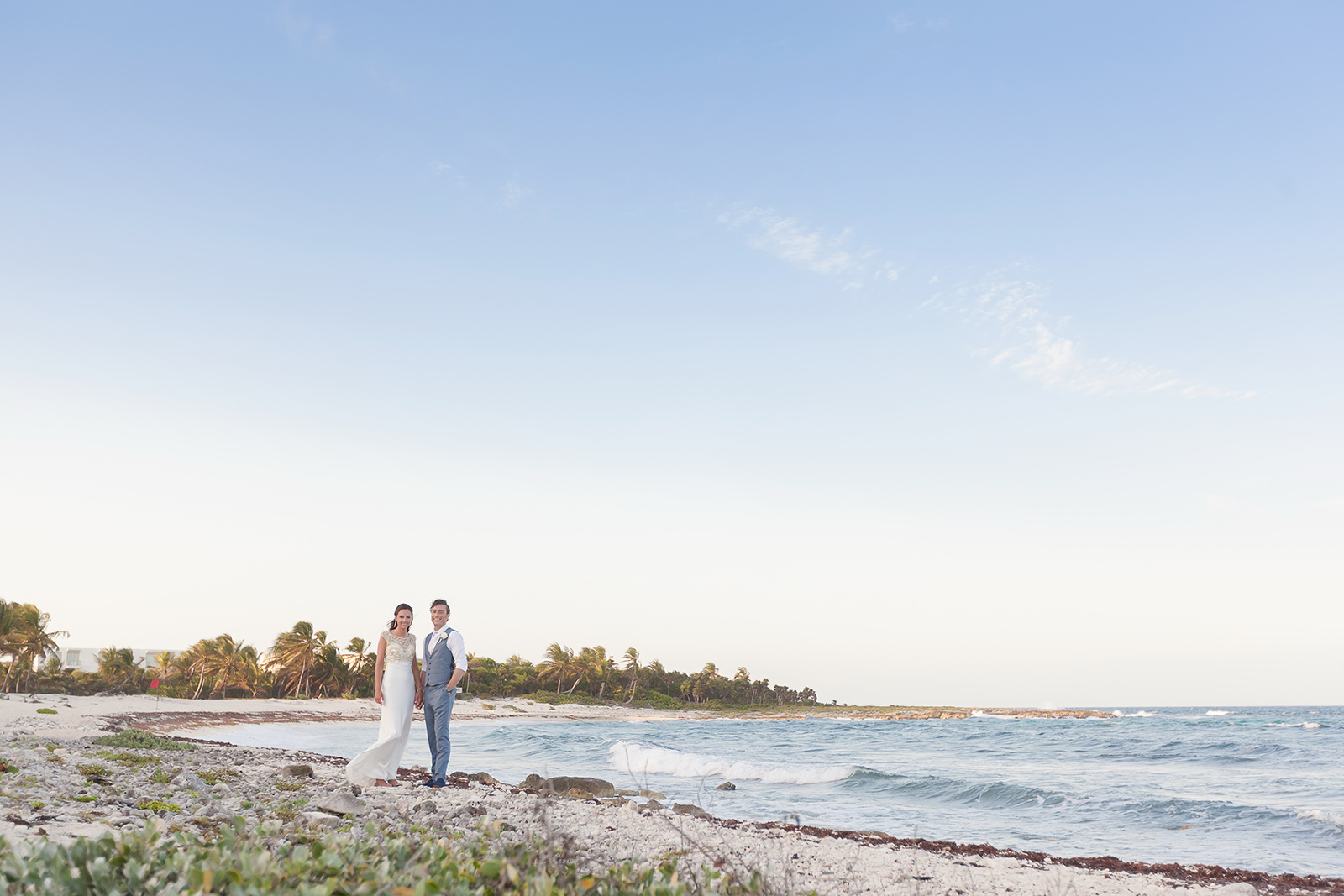 Couple at the beach on their wedding at Grand Sirenis Riviera Maya