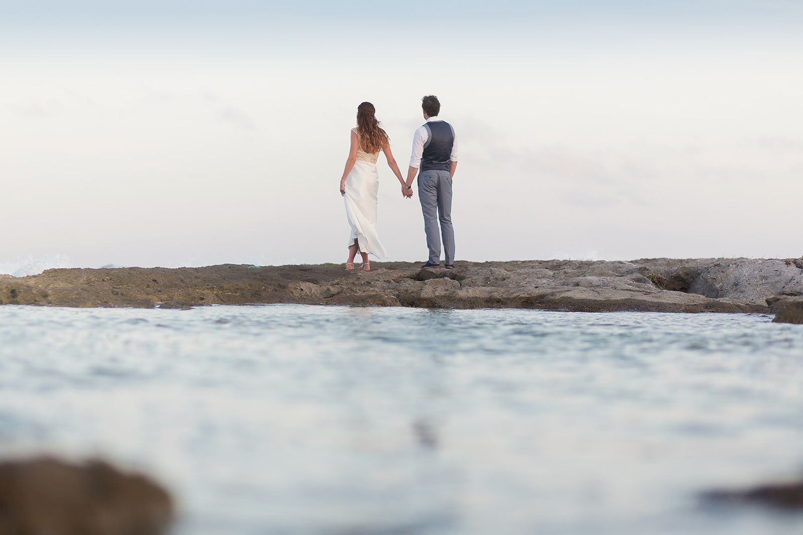 Couple walking on the beach at Riviera Maya Wedding Photography